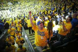 Mark Chiu of Dallas, Tx., celebrates a Golden State Warriors victory over the Portland Trail Blazers 125 to 121 during Game 5 of the NBA Playoffs at Oracle Arena on Wednesday, May 11, 2016 in Oakland, Calif. The Warriors advance to Round 3.