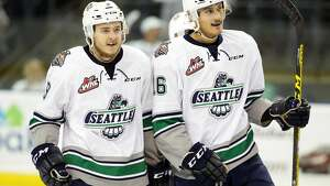 Seattle's Calvin Leth, left, and Alexander True celebrate True's goal (with the assist from Leth) during the second period of the 4th game of the best of seven WHL Championship Series against the Brandon Wheat Kings Wednesday, May 11, 2016 at ShoWare Center in Kent, WA. Thunderbirds won 6-1.  (Genna Martin, seattlepi.com)