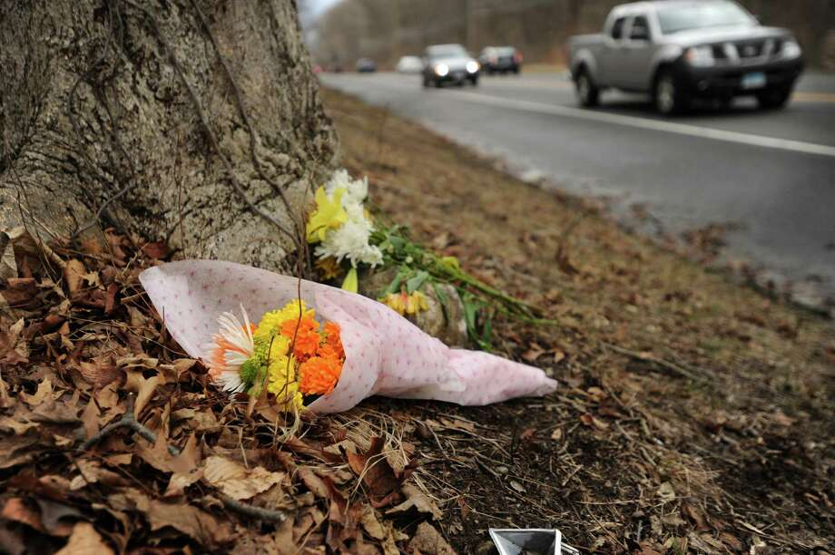 Two small bouquets of flowers are left at the site of Sunday's rollover accident that claimed the life of Edmund Conklin, 17, of Shelton, on Bridgeport Avenue in Shelton, Conn. on Monday, February 29, 2016. Photo: Brian A. Pounds / Hearst Connecticut Media / Connecticut Post