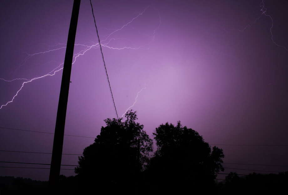 Lightning strikes over route 7 in Brunswick, N.Y, during an overnight thunderstorm on Monday, July 23, 2012. (Dan Little/Special to the Times Union) Photo: Dan Little / Dan Little