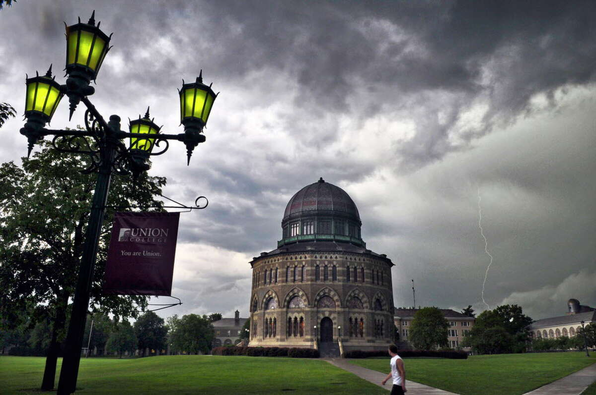 A bolt of lightning can be seen in the distance beyond the Nott Memorial at Union College during storms on Tuesday afternoon May 29, 2012 in Schenectady, NY. (Philip Kamrass / Times Union )