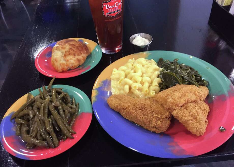 Main dishes at Tony G's Soul Food include a featured item, three sides and choice of a biscuit or cornbread. This is fried catfish, mac and cheese and collard greens.
