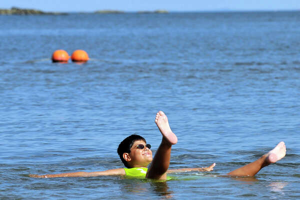 Vincent Reppucci, 9, floats lazily in the water at West Beach in Stamford, Conn., on Wednesday, Aug. 26, 2015. Over parts of the summer Reppucci has been coming to West Beach three to four times a week. This August has been the hottest August on record.