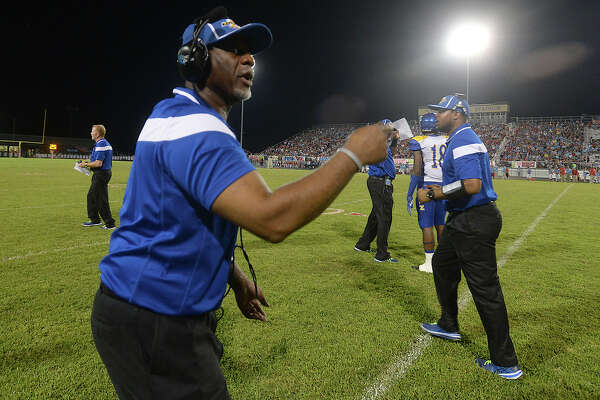 Ozen's coach David Suggs shouts instructions from the sidelines during their district match-up Friday night in Lumberton. Photo taken Friday, September 25, 2015 Photo by Kim Brent