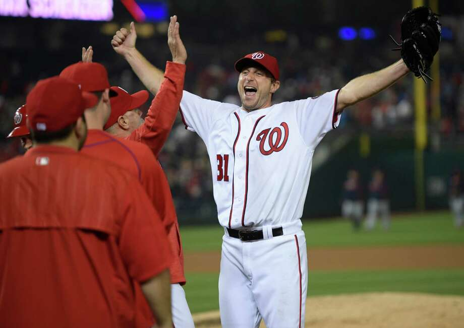 Nationals starting pitcher Max Scherzer rejoices after finishing off the Tigers on Wednesday night. Scherzer struck out 20, joining Roger Clemens and Kerry Wood as the only major league pitchers to reach the milestone in a nine-inning game. Must credit: Washington Post photo by John McDonnell Photo: John McDonnell, The Washington Post / The Washington Post