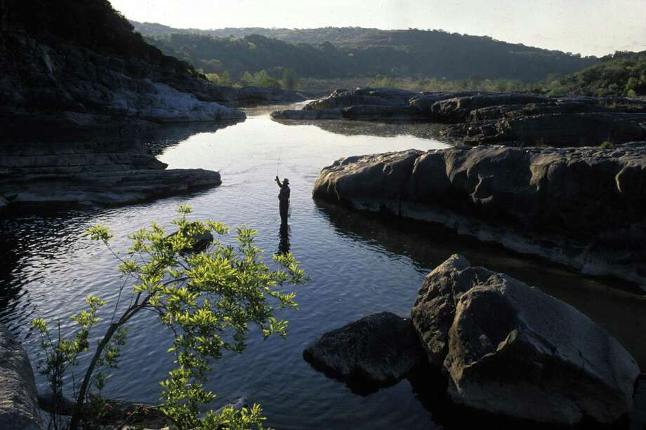 A line fly fisherman is shown wade-casting at Pedernales Falls State Park near Johnson City in 2016. Photo: Courtesy Photo /Texas Parks And Wildlife / handout CD