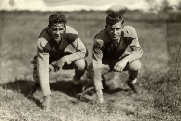 Football players photographed in the 1920s.