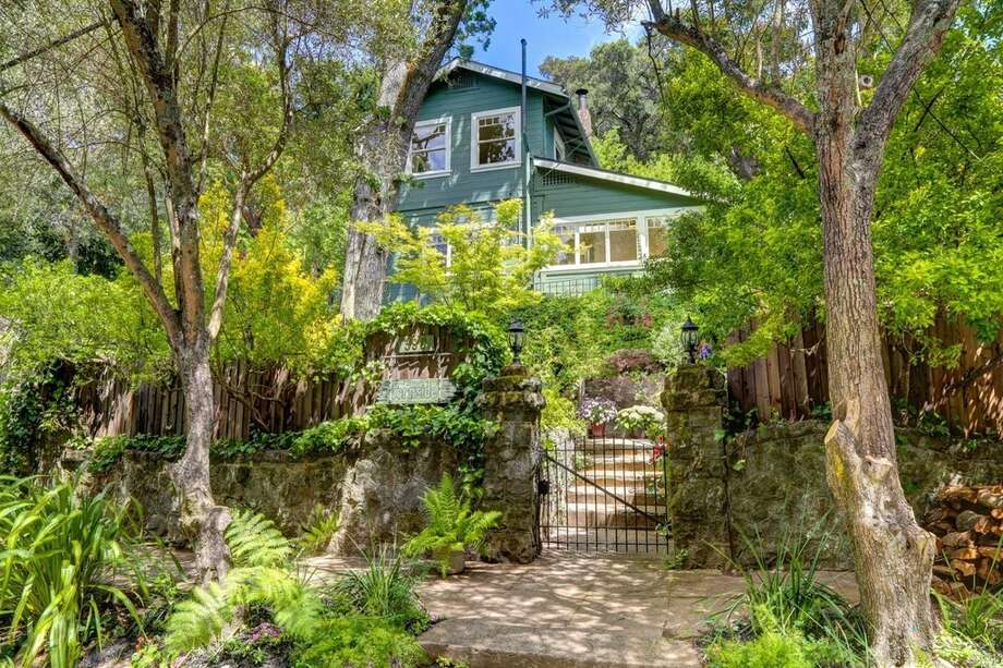 This turn-of-the-century home built before the 1906 earthquake is tucked away on a quiet leafy street. With paneled ceilings and wainscoting, mint green Shaker cabinets in the kitchen and clawfoot tubs in both bathrooms, 399 Forrest Ave., listed on Wednesday for $850,000, oozes charm and character. Photo: Jason Wells