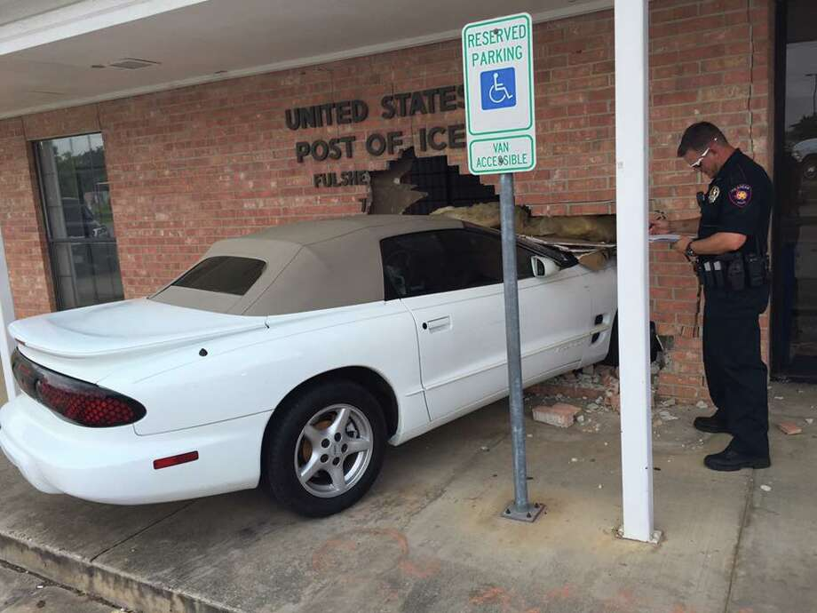 A driver crashed into a U.S. Post Office in Fulshear Thursday, May 12, 2016, when he mistakenly hit the gas pedal instead of the brakes. (Fulshear Police Department)