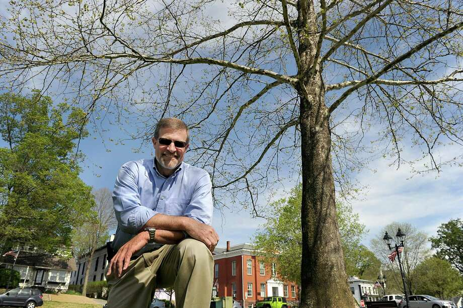 Carlos Caridad, New Milford's tree warden, stands near one of two sycamore trees he transplanted on the New Milford Green in 2000. Photo: Carol Kaliff / Hearst Connecticut Media / The News-Times