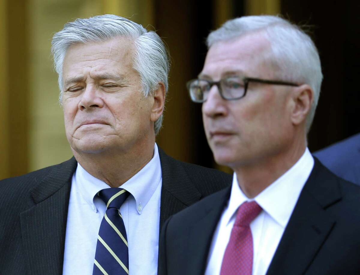 Former Senate majority leader Dean Skelos, left, reacts as he leaves court in New York, Thursday, May 12, 2016. The once-powerful New York politician convicted of using his position as Senate majority leader to pressure companies to provide hundreds of thousands of dollars for his son was sentenced Thursday to five years in prison, the latest in a spate of corruption cases that have roiled Albany. (AP Photo/Seth Wenig) ORG XMIT: NYSW114
