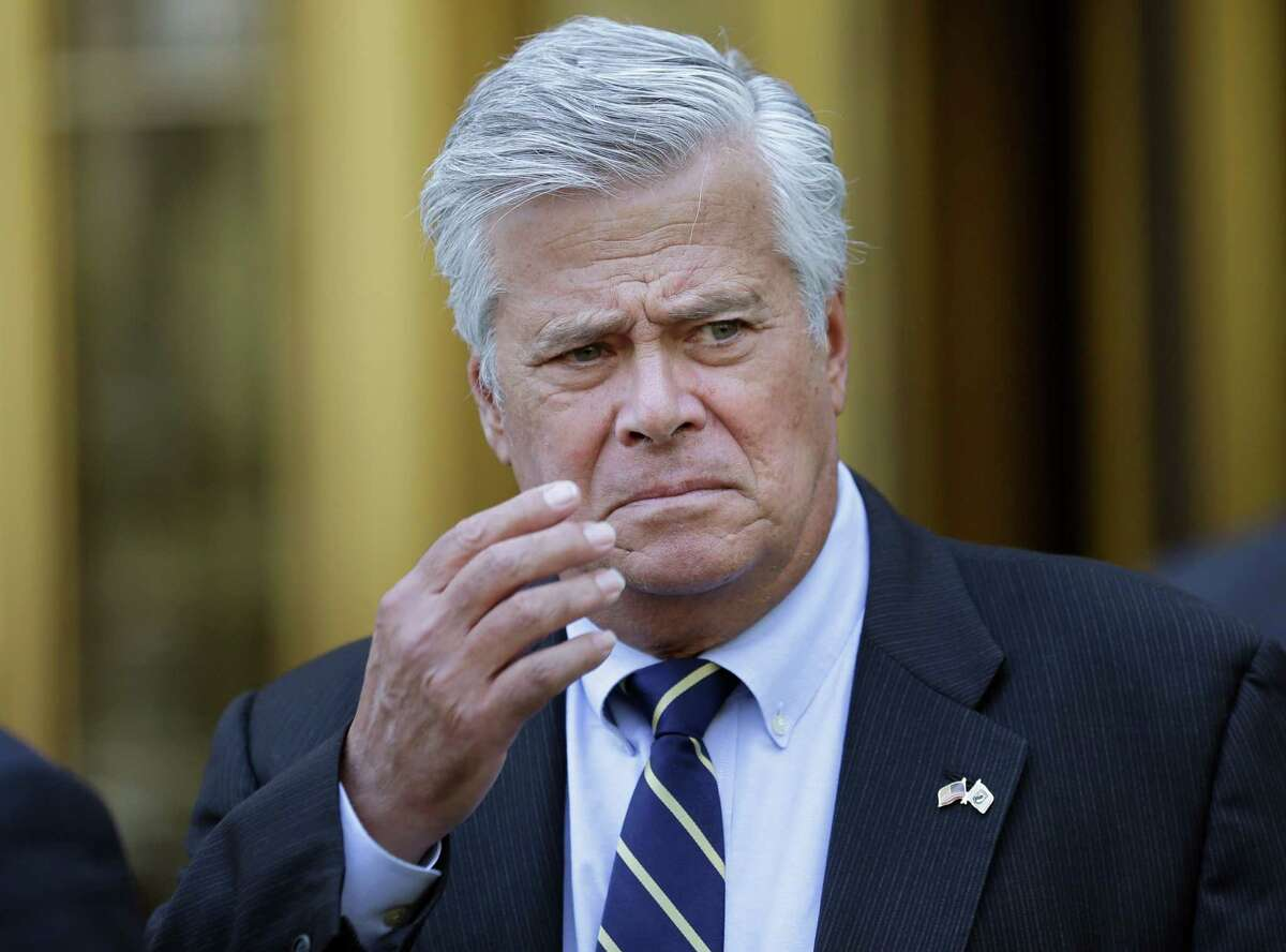 Former Senate majority leader Dean Skelos reacts as he leaves court in New York, Thursday, May 12, 2016. The once-powerful New York politician convicted of using his position as Senate majority leader to pressure companies to provide hundreds of thousands of dollars for his son was sentenced Thursday to five years in prison, the latest in a spate of corruption cases that have roiled Albany. (AP Photo/Seth Wenig) ORG XMIT: NYSW116