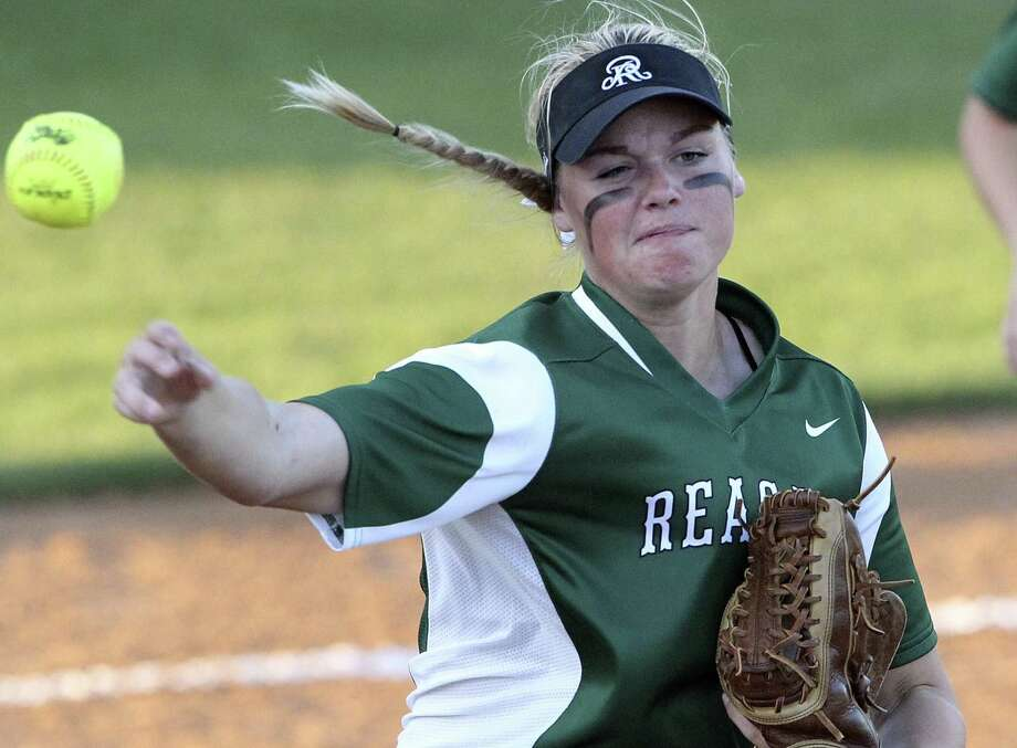 Morgan Hanz fires to first for an out as Reagan plays Brennan in Game 1 of a best-of-3 Class 6A second-round softball playoff series at SAISD Complex on May 6, 2016. Photo: Tom Reel /San Antonio Express-News / 2016 SAN ANTONIO EXPRESS-NEWS