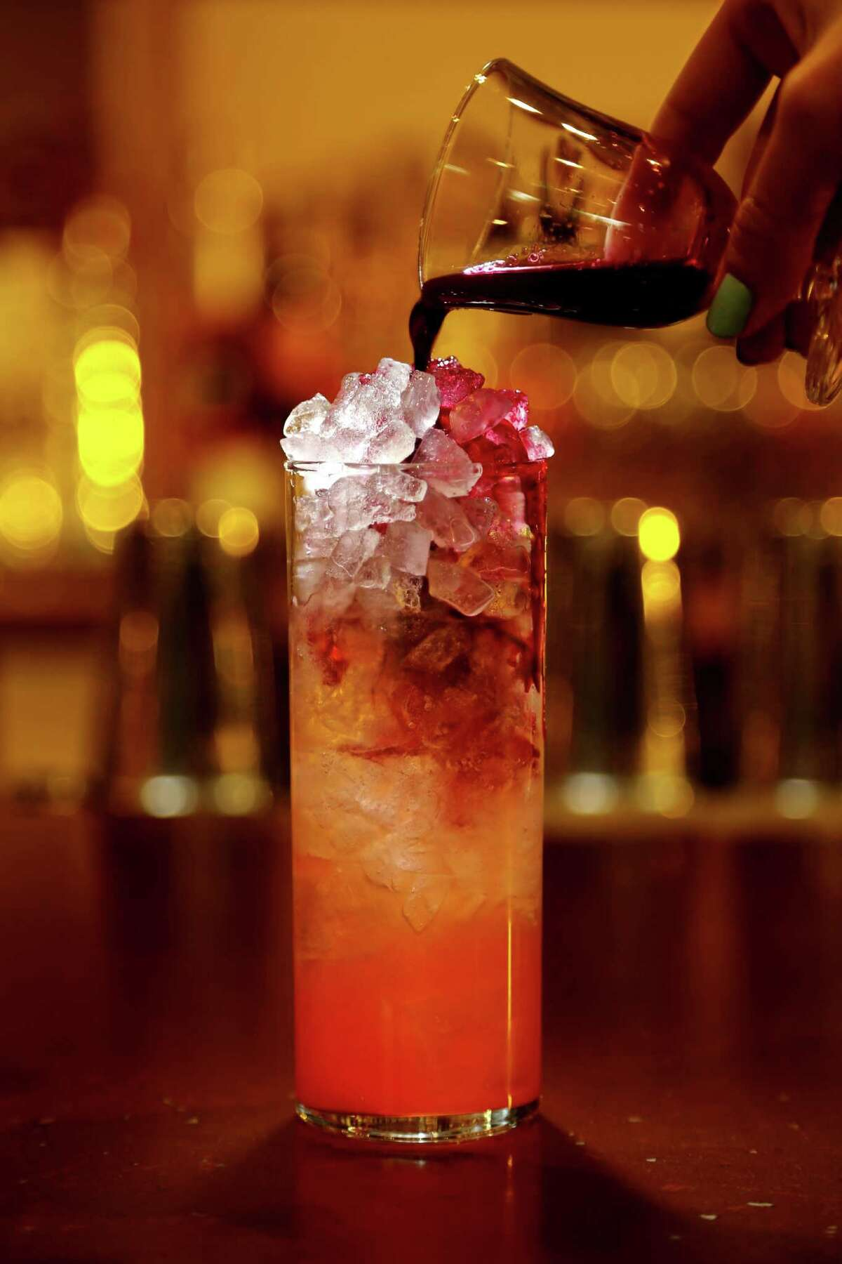 "A Tokyo ""Sunset;"" tequila or vodka, aperol, beet, lemon, and soda served at Izakaya in Midtown."