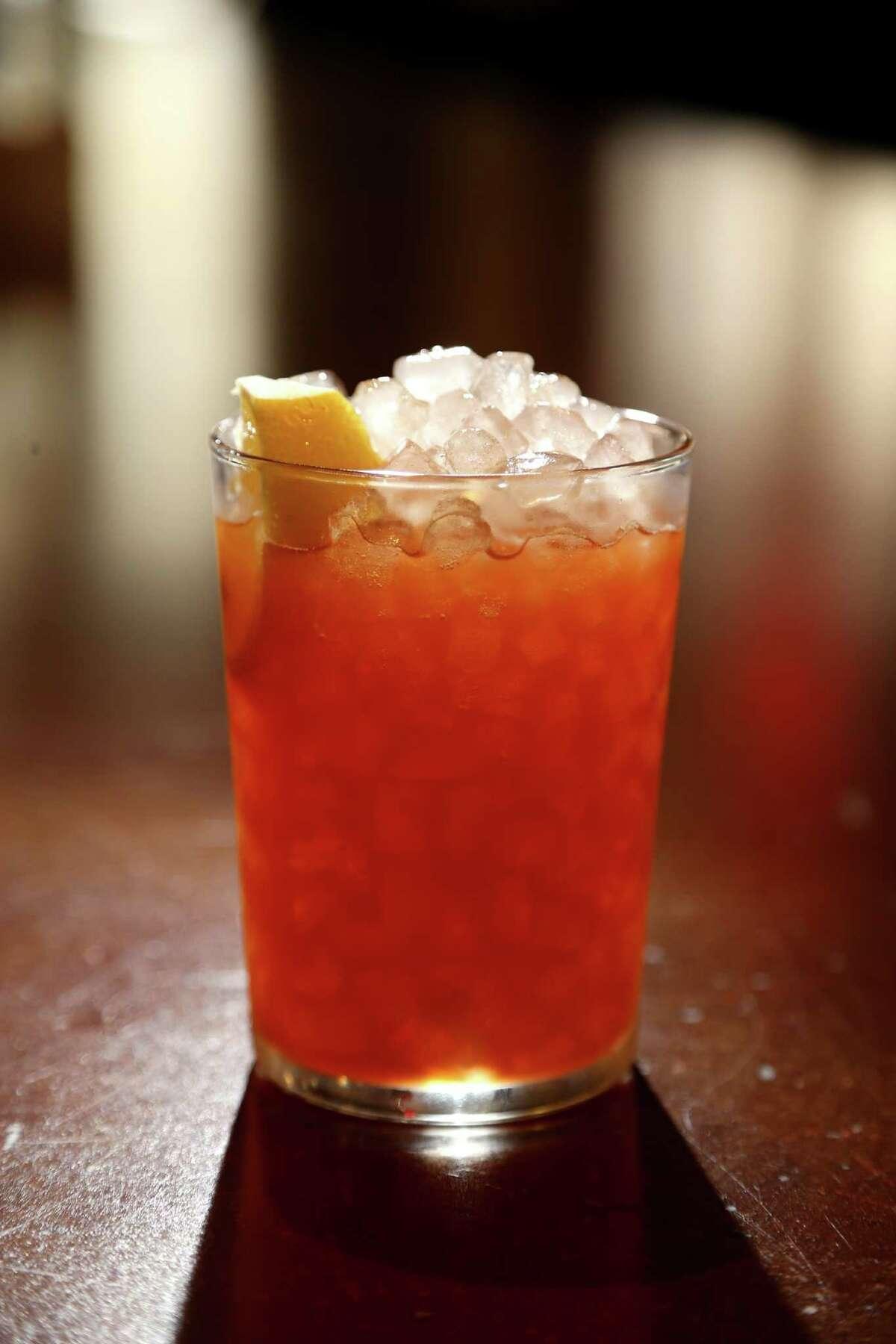A Mid-Ocean Cooler; bourbon, rhubarb, Thai ginger, carrot and lemon served at Izakaya in Midtown Houston.