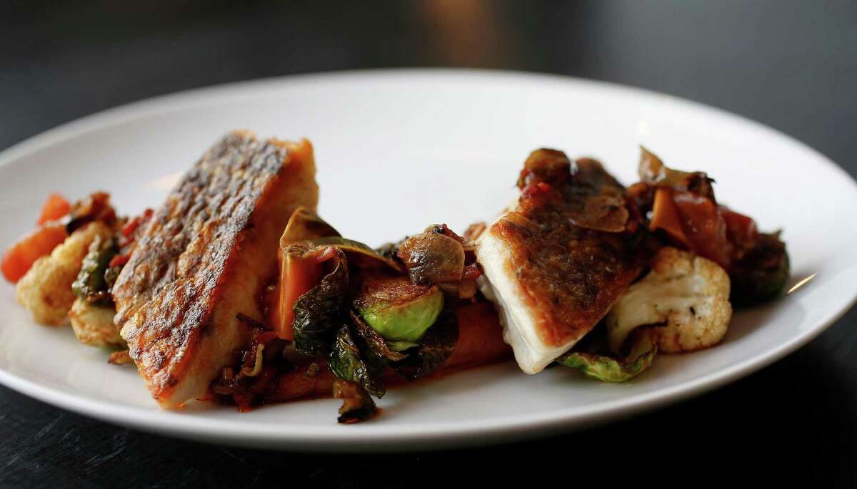 Simply grilled redfish with seasonal vegetables at Holley's