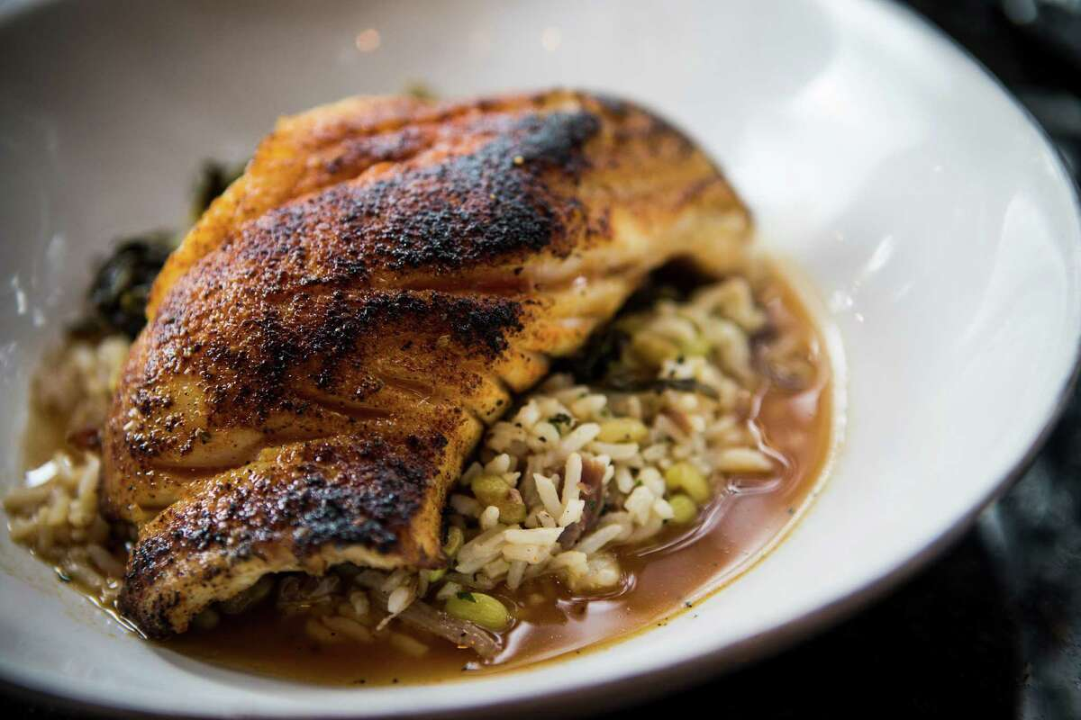 Blackened grouper with Carolina Gold rice, lady creamer peas, kimchi greens and ham hock pot liquor at Holley's