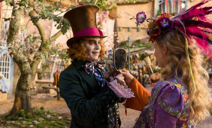 """Johnny Depp as the Mad Hatter and Mia Wasikowska as Alice in """"Alice Through the Looking Glass"""""""
