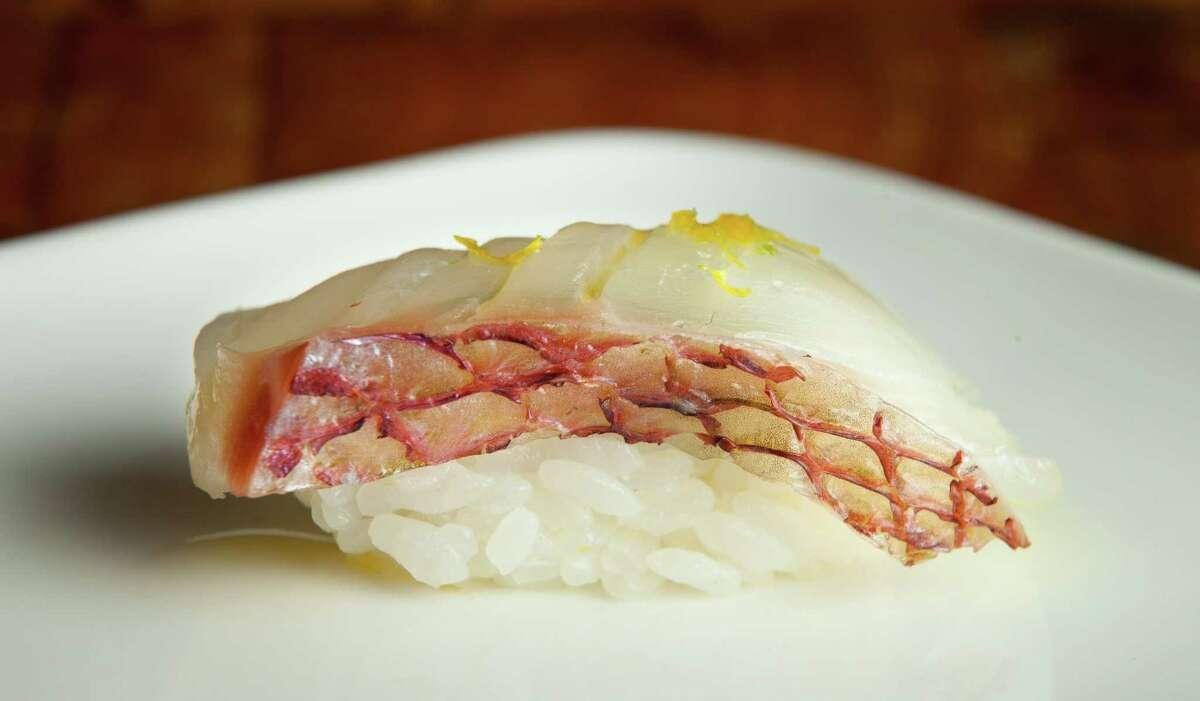 Hirame usuzukuri, thinly sliced flounder sashimi, candied quinoa, olive oil at Uchi