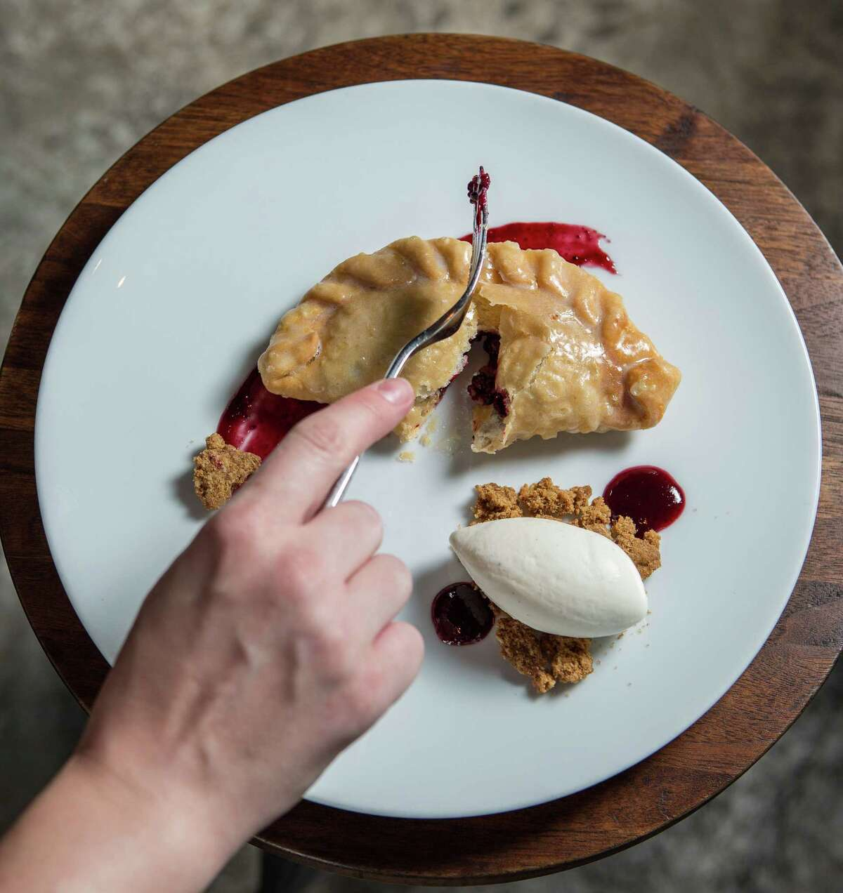 Underbelly restaurant's fried pie served with vanilla ice cream