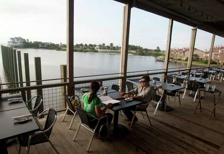 Waterman's Restaurant in Galveston has a back porch overlooking Lake Como.