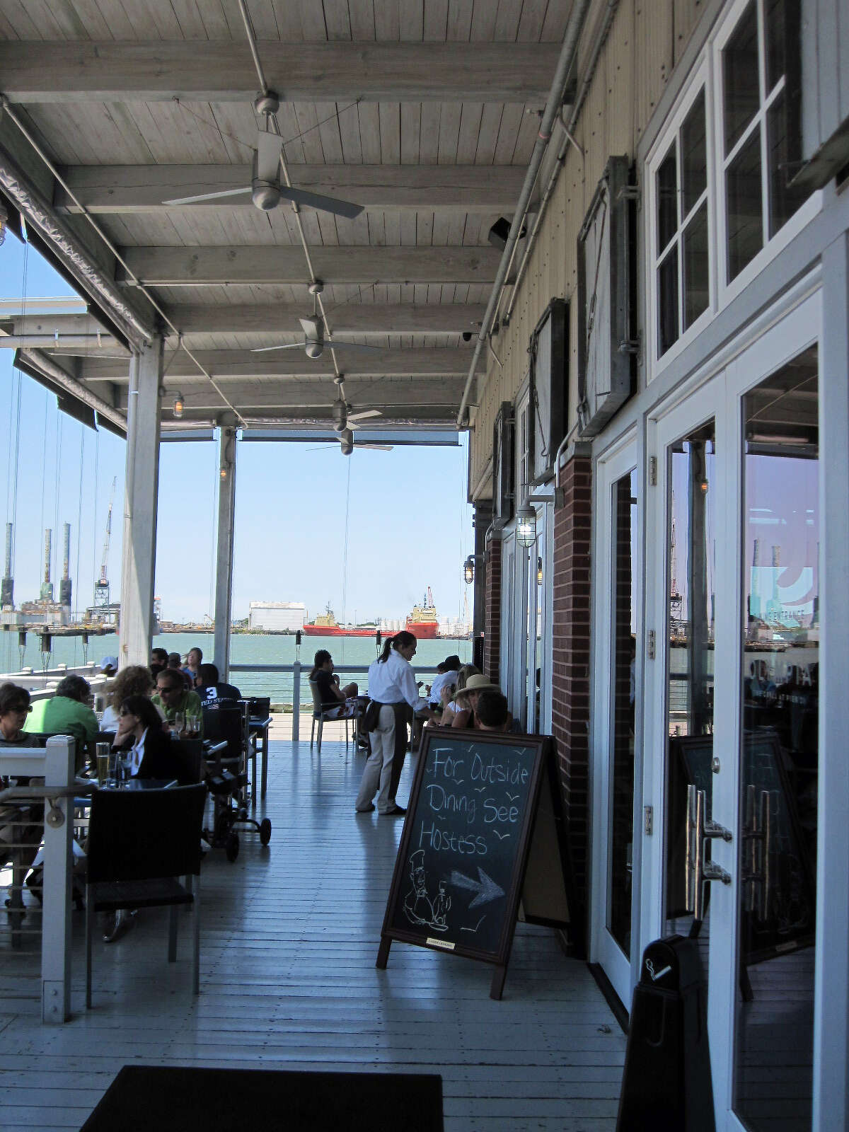 Olympia Grill at Pier 21 in Galveston looks our on Galveston harbor.