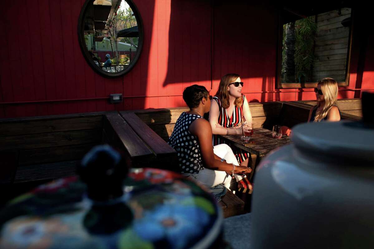 Friends soak up the last of the afternoon sun on Boheme's patio.