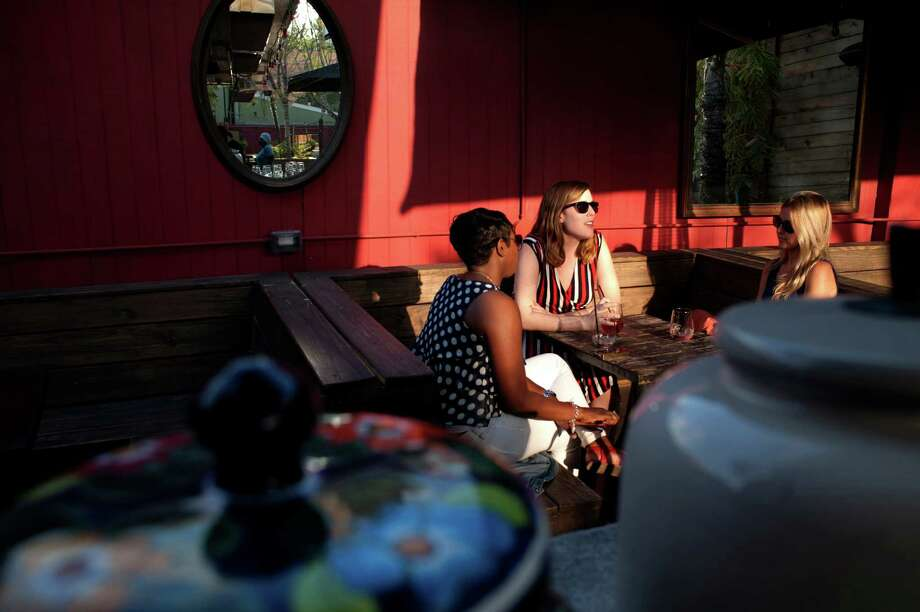 Friends Soak Up The Last Of The Afternoon Sun On Bohemeu0027s Patio. Photo:  Spike
