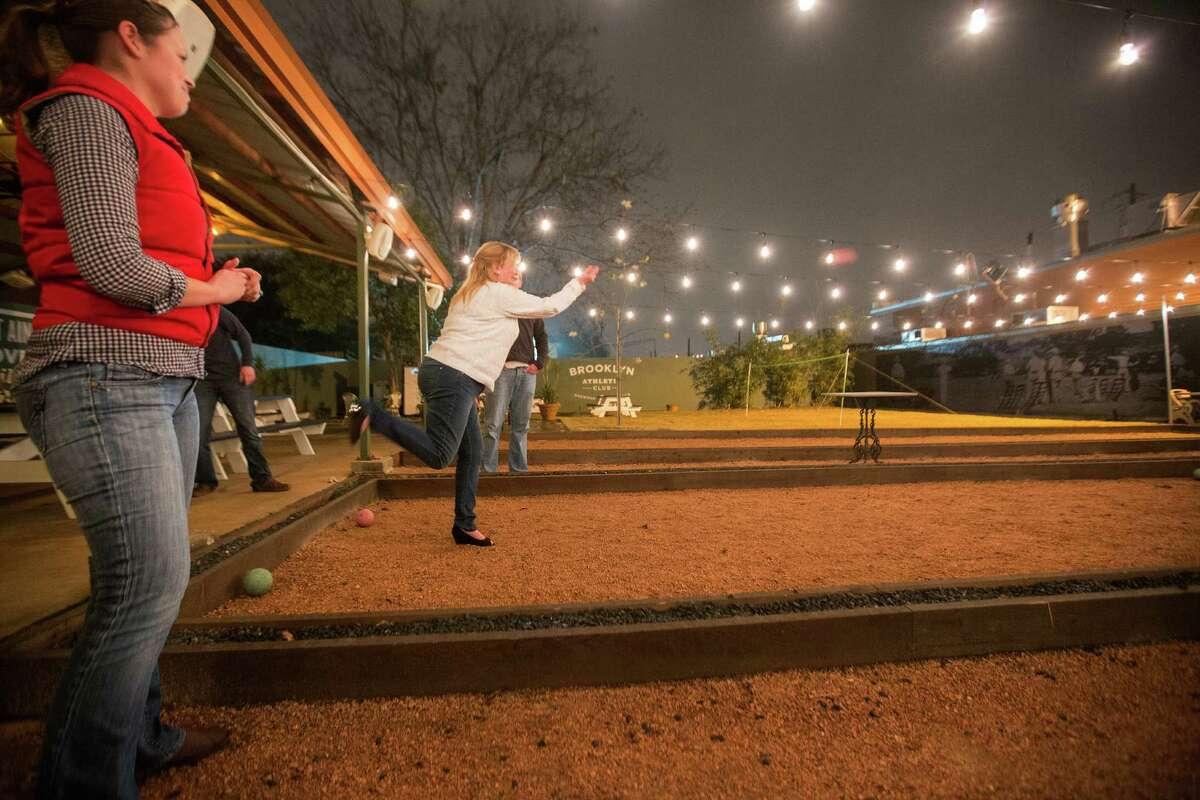 Patrons play bocce ball at Brooklyn Athletic Club