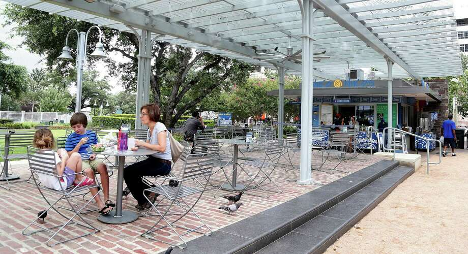 Dining al fresco at Niko Niko's in Market Square Park downtown is a treat. Photo: Karen Warren, Staff / © 2014 Houston Chronicle
