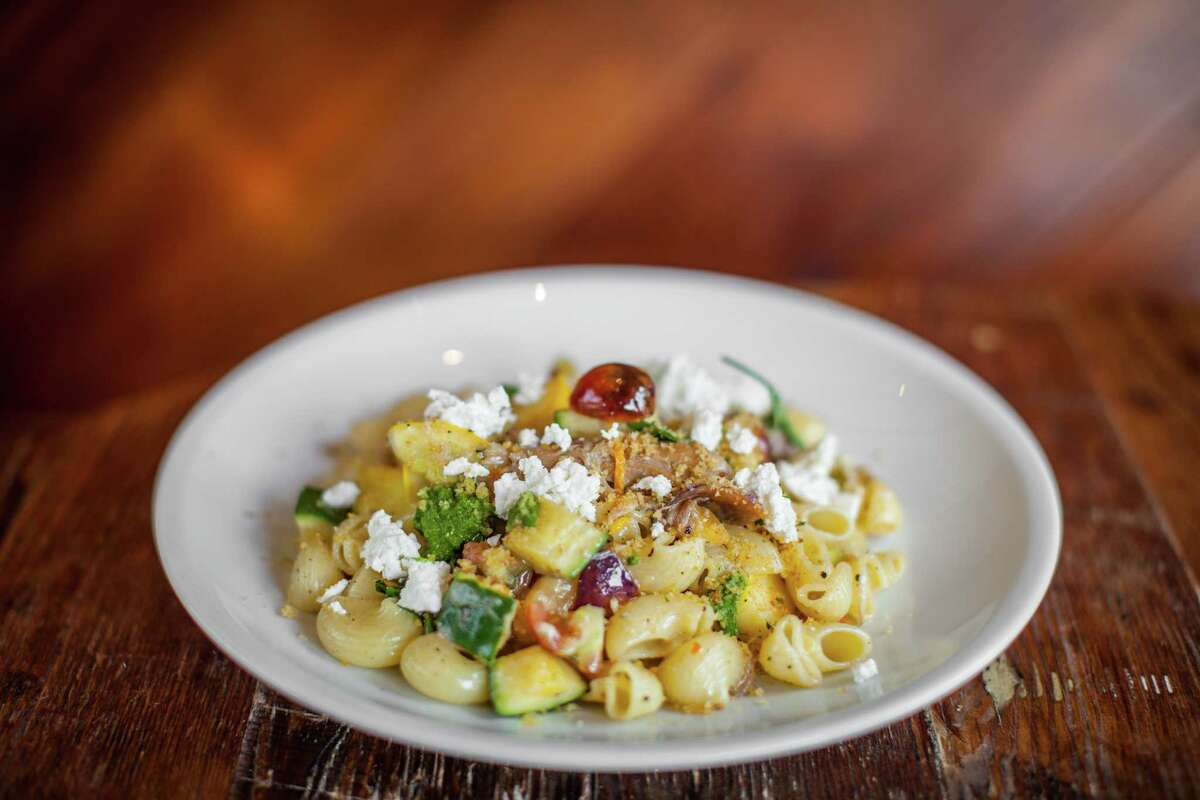 Coltivare's rigatoni, summer vegetables, slow cooked duck, herbs, bread crumbs, and goat milk ricotta