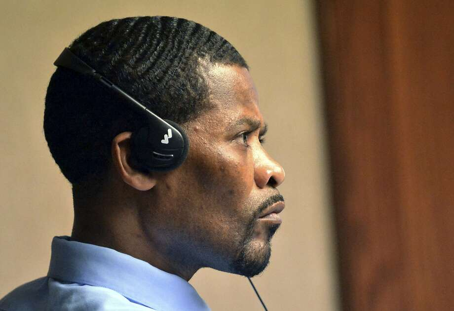 Haitian immigrant Jean Jacques listens to an interpreter through his headset during his murder trial in New London, Conn., last month. The U.S. tried unsuccessfully to deport Jacques. Photo: Aaron Flaum, Associated Press