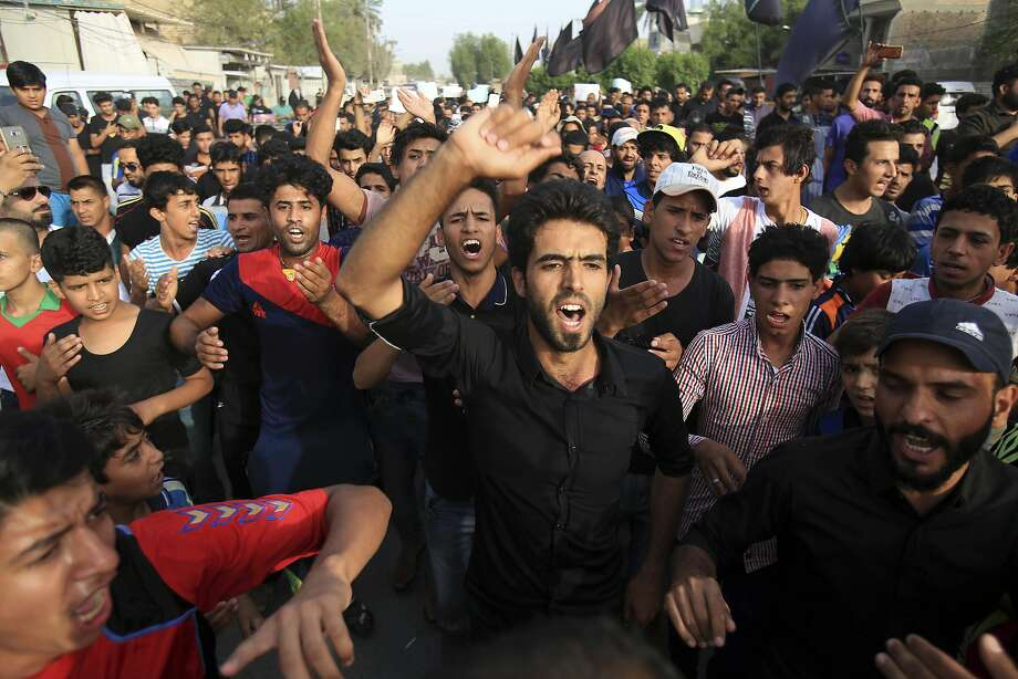 Baghdad residents protest the failure of security forces to protect them at the site of a car bomb attack. Photo: Karim Kadim, Associated Press
