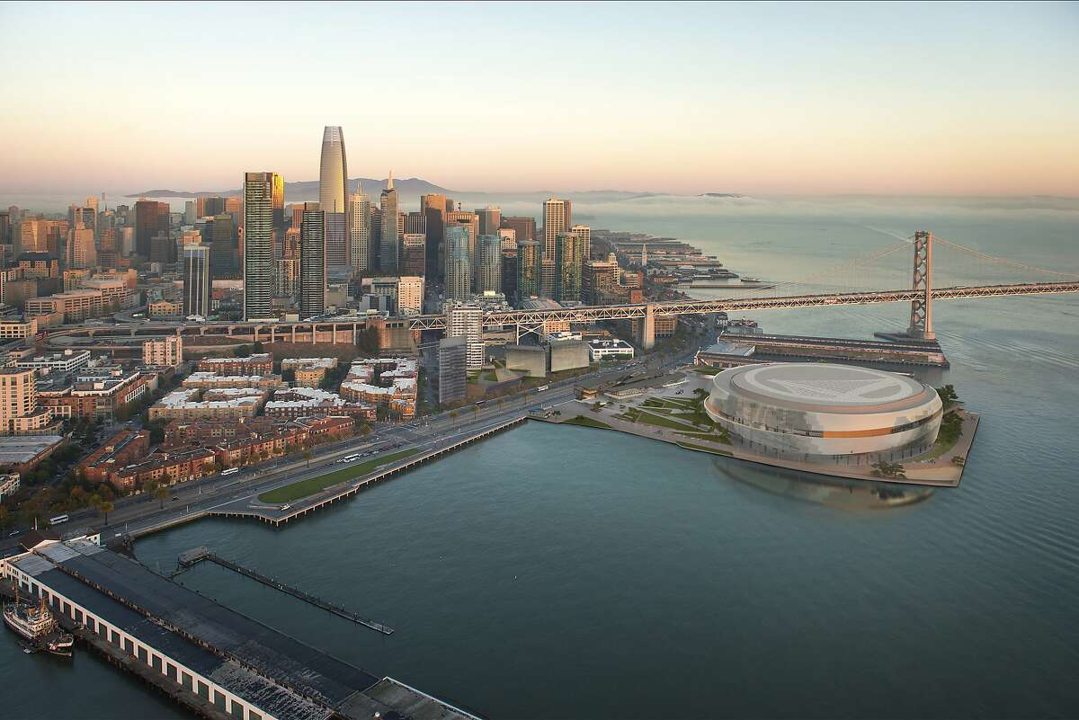 Aerial view of the Golden State Warriors proposed arena and neighboring development across the Embarcadero. The team�s redesign being released Tuesday includes trimming the perimeter height of the arena and lowering public plazas to make them more welcoming to pedestrians.