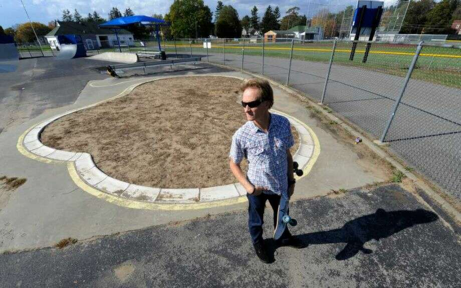 Charlie Samuels standing in front of the skate bowl before the park was re-opened. Skip Dickstein/ Times Union