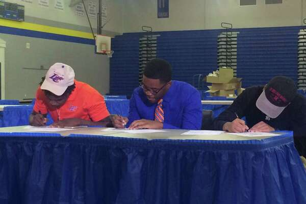 Dedren Harrington (left) and Arthur Harmon (middle) signed with Louisiana College and Emmanuel Smith (right) signed with Sul Ross State University. (Brooks Kubena/The Enterprise)