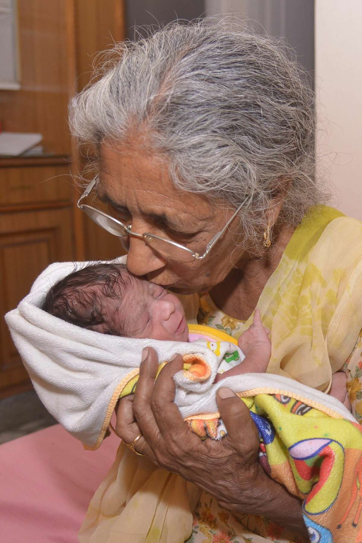 Indian mother Daljinder Kaur, 70, poses for a photograph as she holds her newborn baby boy Arman at their home in Amritsar on May 11, 2016. An Indian woman who gave birth at the age of 70 said May 10 she was not too old to become a first-time mother, adding that her life was now complete. Daljinder Kaur gave birth last month to a boy following two years of IVF treatment at a fertility clinic in the northern state of Haryana with her 79-year-old husband.
