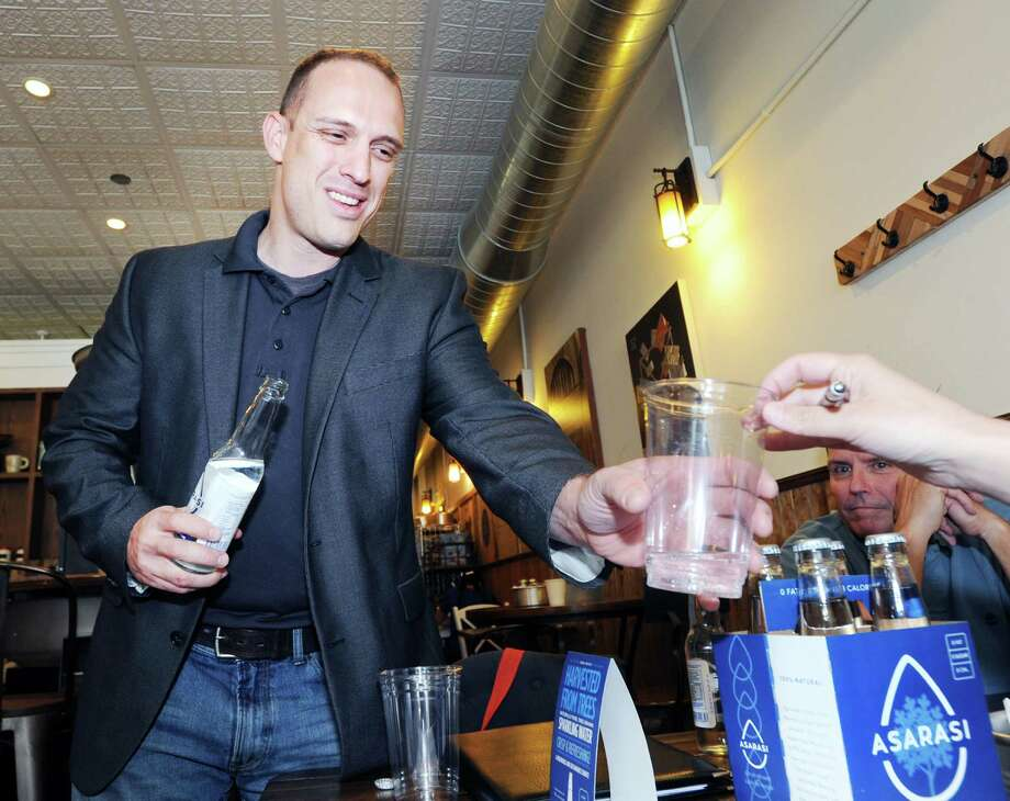 Asarasi Chief Executive Officer, Adam Lazar, serves his company's sparkling tree-drawn water at Sweet Pea's Baking Company, one of the location's where the product is sold in Old Greenwich, Conn., May 10, 2016. Photo: Bob Luckey Jr. / Hearst Connecticut Media / Greenwich Time