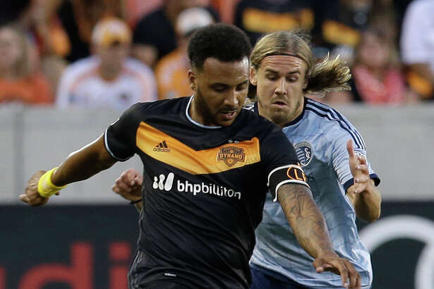 Houston Dynamo Giles Barnes, left, keeps the ball away from Sporting Kansas City Chance Myers during of game at BBVA Compass Stadium Saturday, May 7, 2016, in Houston.  ( Melissa Phillip / Houston Chronicle )