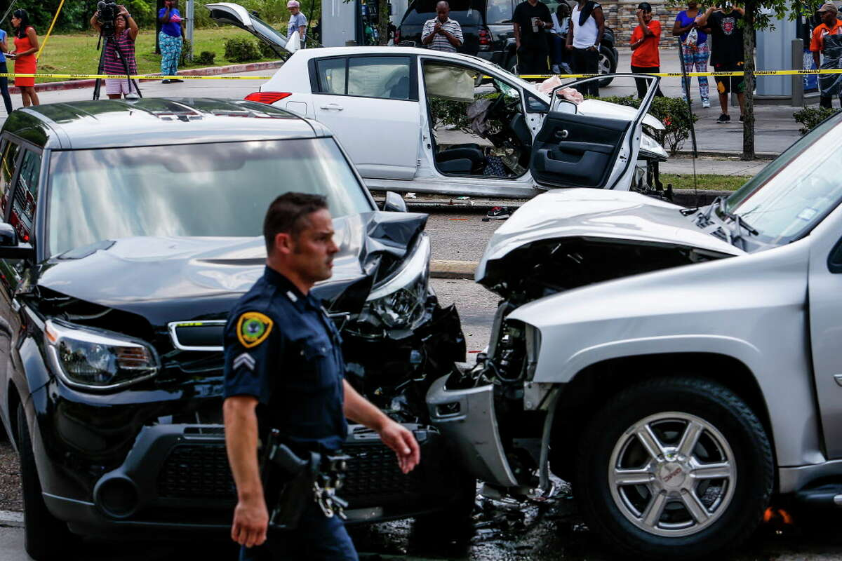 Police investigate after a car chase ended with the suspect crashing the silver SUV into two cars at the intersection of Scott Street and Yellowstone Boulevard Thursday, May 12, 2016 in Houston. The suspect exited the vehicle and attempted to run away but was caught close by.
