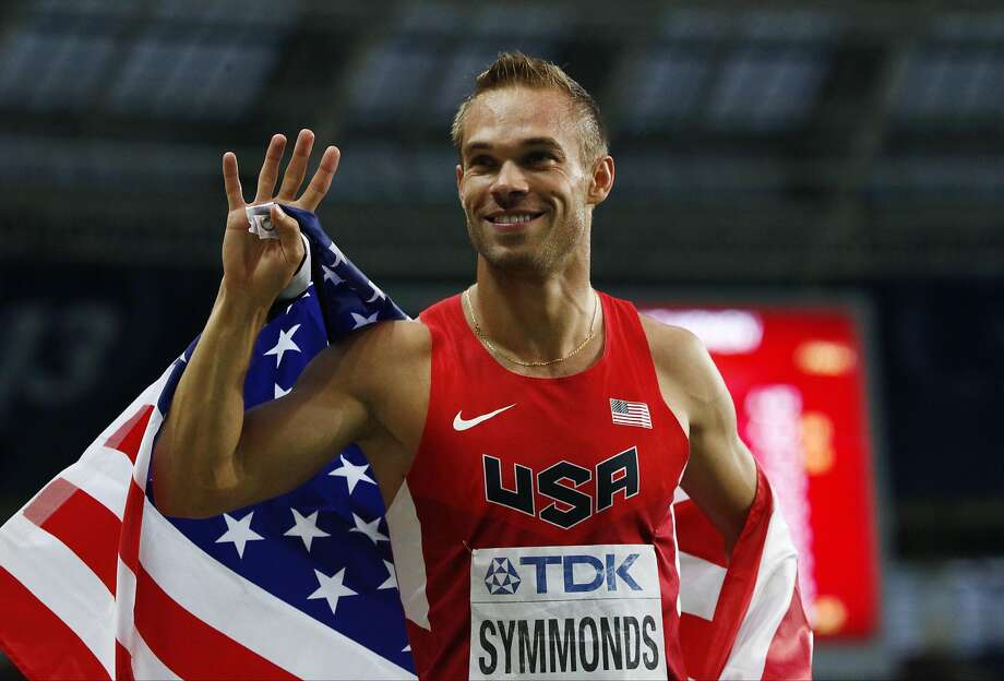 FILE - In this Aug. 13, 2013, file photo, United States' Nick Symmonds celebrates after winning bronze in the men's 800-meter final at the World Athletics Championships in the Luzhniki stadium in Moscow. Symmonds is boycotting world championships that begin Saturday, Aug. 22, 2015, in protest of what he said is an unfair contract that forced him to wear Nike gear at all team functions. (AP Photo/Alexander Zemlianichenko, File) Photo: Alexander Zemlianichenko, Associated Press