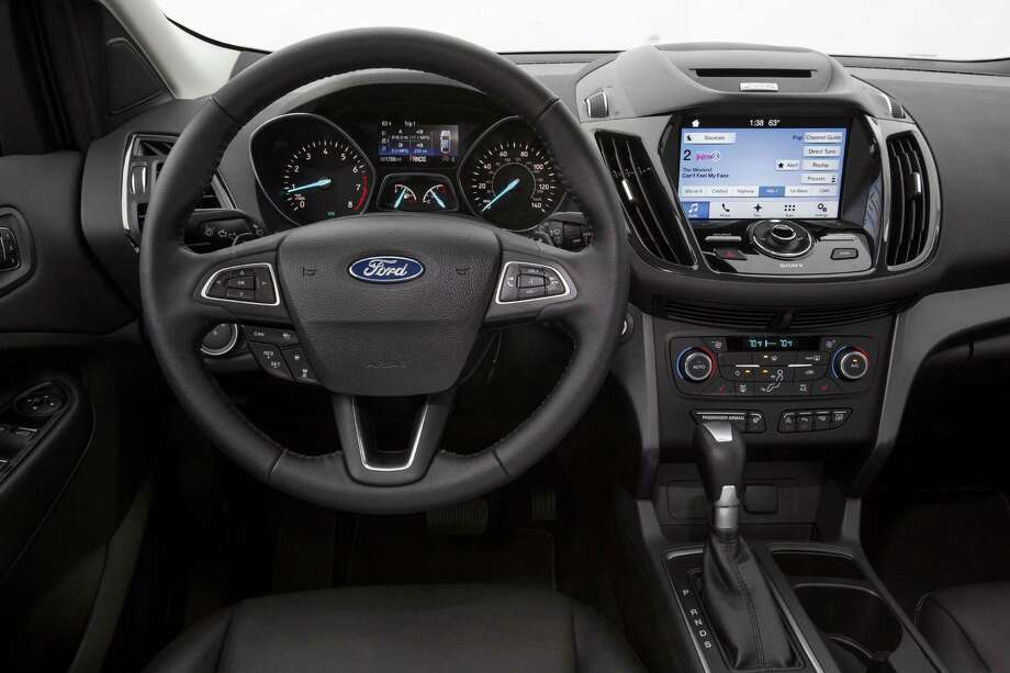 The 2017 Ford Escape Titanium's new steering wheel has easy-to-work buttons to control audio, adaptive cruise control and initiate Sync 3 voice commands. Photo: Ford