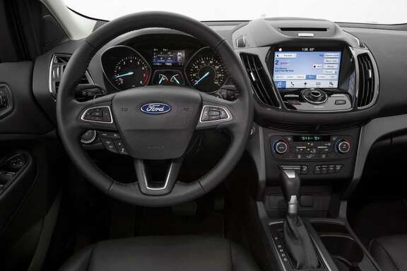 The 2017 Ford Escape Titanium's new steering wheel has easy-to-work buttons to control audio, adaptive cruise control and initiate Sync 3 voice commands.