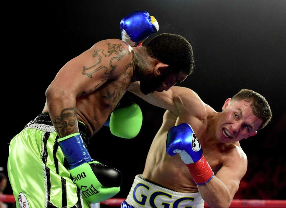 Gennady Golovkin punches Dominic Wade on way to a second-round TKO during his unified middleweight title fight at The Forum on April 23, 2016 in Inglewood, Calif. Photo: Harry How /Getty Images / 2016 Getty Images