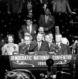 """FILE - In this July 14, 1960, file photo, U.S. Sen. John F. Kennedy tells Democratic convention delegates, """"we will carry the fight to the people in the fall and we shall win,"""" during a brief appearance on the rostrum of the Los Angeles Sports Arena in Los Angeles, where he was nominated as the party's presidential candidate during the Democratic National Convention. The Los Angeles Memorial Sports Arena is about to become just a memory. City leaders are holding a closing ceremony Thursday, May 12, 2016, for the building that hosted to some of the 20th century's biggest moments in sports, politics and rock 'n' roll. (AP Photo/File)"""