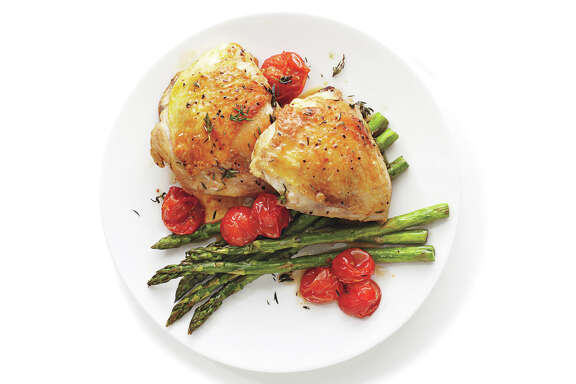 "Roasted Chicken with Asparagus and Grape Tomatoes, from ""Dinner Made Simple."""