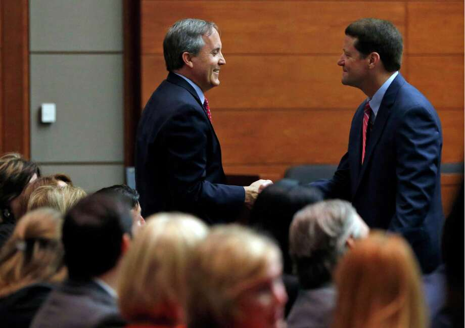 Texas Attorney General Ken Paxton, left, shakes hands with his attorney Bill Mateja after entering the Merrill Hartman Courtroom in the Fifth Court of Appeals at the George Allen Courts Building in Dallas, Thursday May 12, 2016. Paxton's legal team is asking an appeals court to toss criminal charges he defrauded investors. Paxton also faces separate civil fraud charges filed by the U.S. Securities and Exchange Commission. (Rose Baca/The Dallas Morning News via AP) Photo: Rose Baca, MBR / Associated Press / The Dallas Morning News