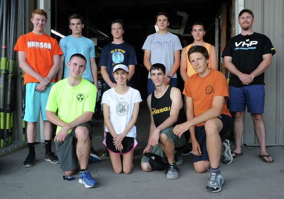 Albany Rowing Center boys' Varsity 8 boat, back row left to right, Connor Toomey, Quinn Maguire, Matt Sicko, Christian Sauer, Evan Kimble, Coach Andy Sayles, bottom row left to right, Dylan MacQuoid, coxswain Claire Connally, David Wirth and Ian Davis pose for a photo in front of the boat house at Jennings Landing on Thursday, May 1, 2016 in Albany, N.Y. (Lori Van Buren / Times Union) Photo: Lori Van Buren / 20036565A