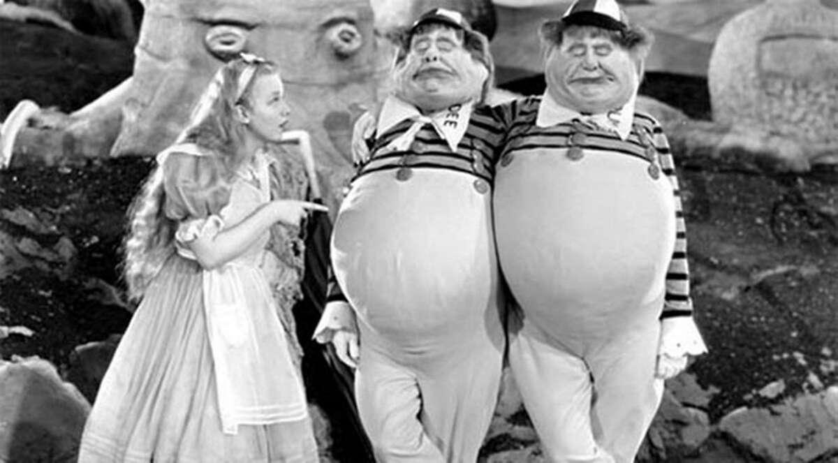 "Alice (Charlotte Henry) with Tweedledee (Roscoe Karns) and Tweedledum (Jack Oakie) in ""Alice in Wonderland"" (1933). Courtesy of Universal Studios Home Entertainment."