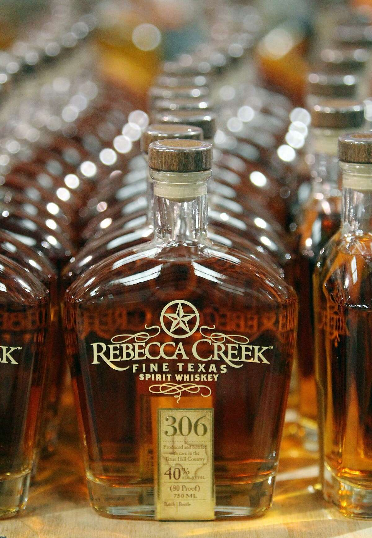 Sealed bottles of Rebecca Creek Distillery's whiskey wait to be packed and shipped.